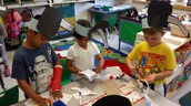 Krishav, Riley, and Ethan making their puppets!