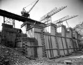 cranes help build the dam