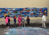 Ms. Liwacz's students venture by the mural