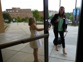 ABBY GREETS A COLLEGE REPRESENTATIVE