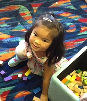 Hanna is working hard on building a tall tower