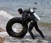 A Diver Fishes Out Trash