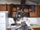 Stove caught on fire and burnt cabinets