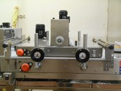 MOTOR DRIVEN TOP BELT and height adjustable pressing board