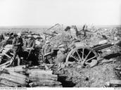 1917- Australian soldiers load an artillery shell during the Battle of Passchendaele