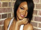 Rihanna plays the guittar