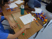 Manipulatives in math. Students learn at the concrete and representational level before the abstract