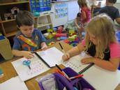 Working on their interactive alphabet journals