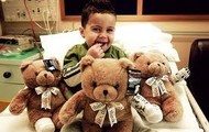 A boy with three bandaged bears.