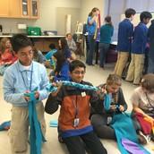 Students making dog toys