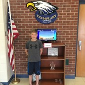 Ryder Holland set up our new Weather Bug monitors in the building.