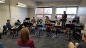 Jazz band performing for staff before school