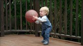 Baby throwing ball
