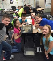 Mrs. Bottom's students observing the effects of erosion on soil.