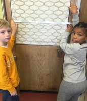 Using measuring strips to measure other papers and surfaces in our classroom