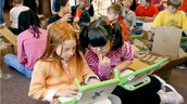 Roxy volunteers at after school programs to help children with their school work.