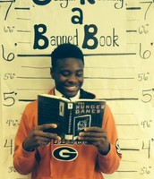 KHS Senior Sayvion Moye with a challenged book during Banned Book Week